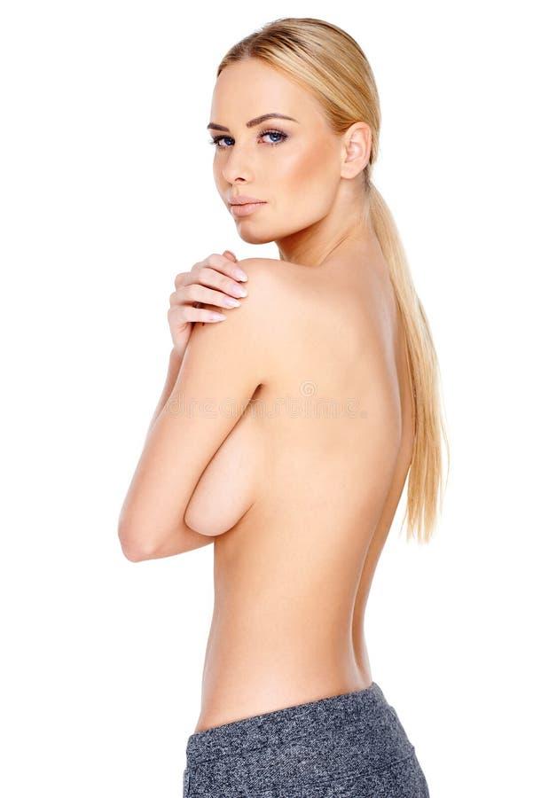 Mulher loura em topless na vista lateral foto de stock royalty free