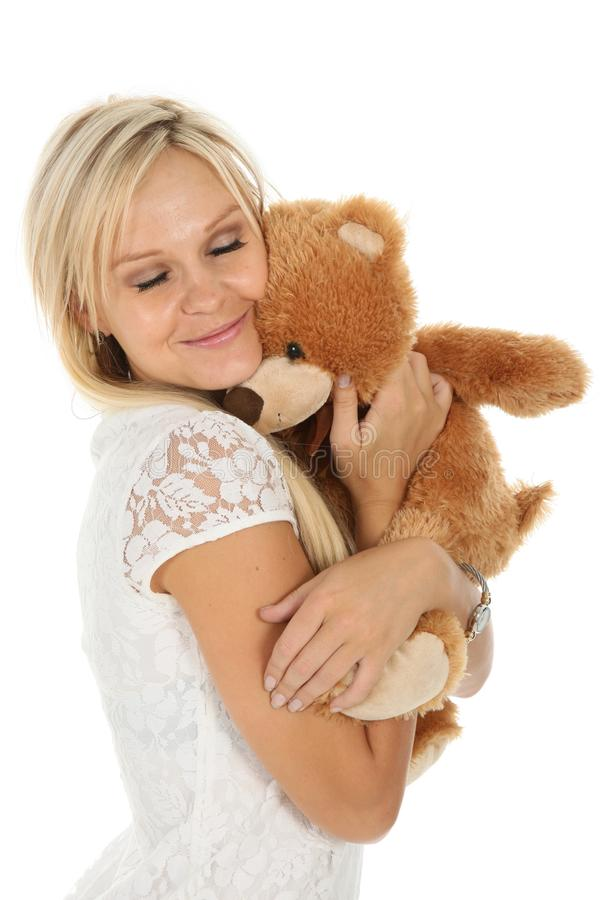Mulher loura encantadora com animal do brinquedo fotografia de stock royalty free