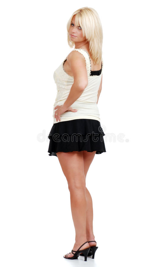 Mulher loura madura na mini saia imagens de stock