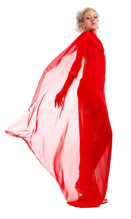 Mulher loura na tela vermelha fotografia de stock