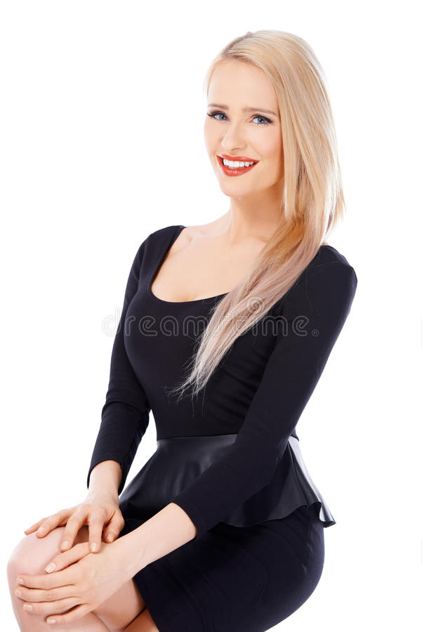 Mulher loura 'sexy' no vestido preto fotos de stock
