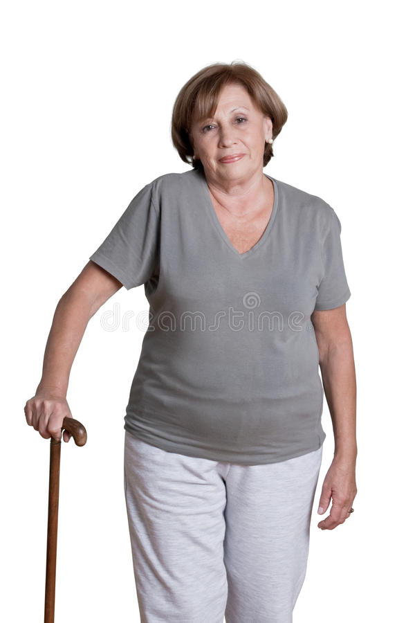 Mulher madura com vara de passeio fotografia de stock