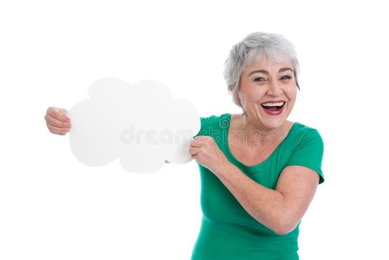 Mulher mais idosa de cabelo cinzenta que guarda um sinal em sua mão fotos de stock