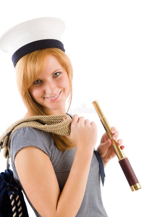 Mulher marinha nova com o spyglass no chapéu do marinheiro foto de stock royalty free