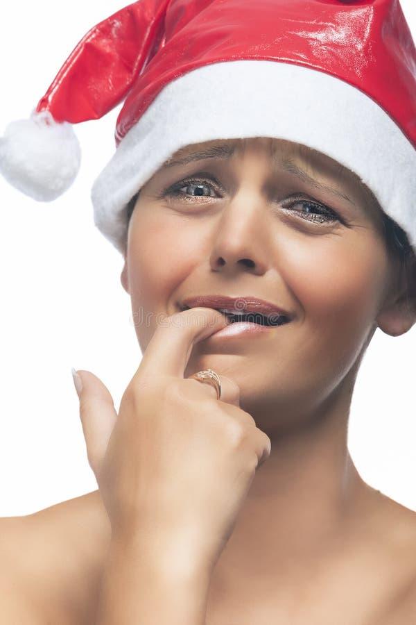 Mulher moreno caucasiano emocional em Santa Hat imagem de stock