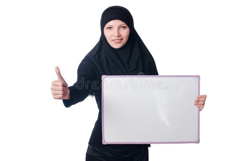 Mulher muçulmana com placa vazia foto de stock