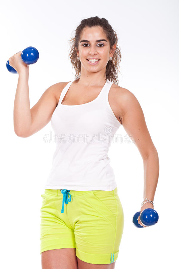 Mulher muscular desportiva que elabora fotos de stock