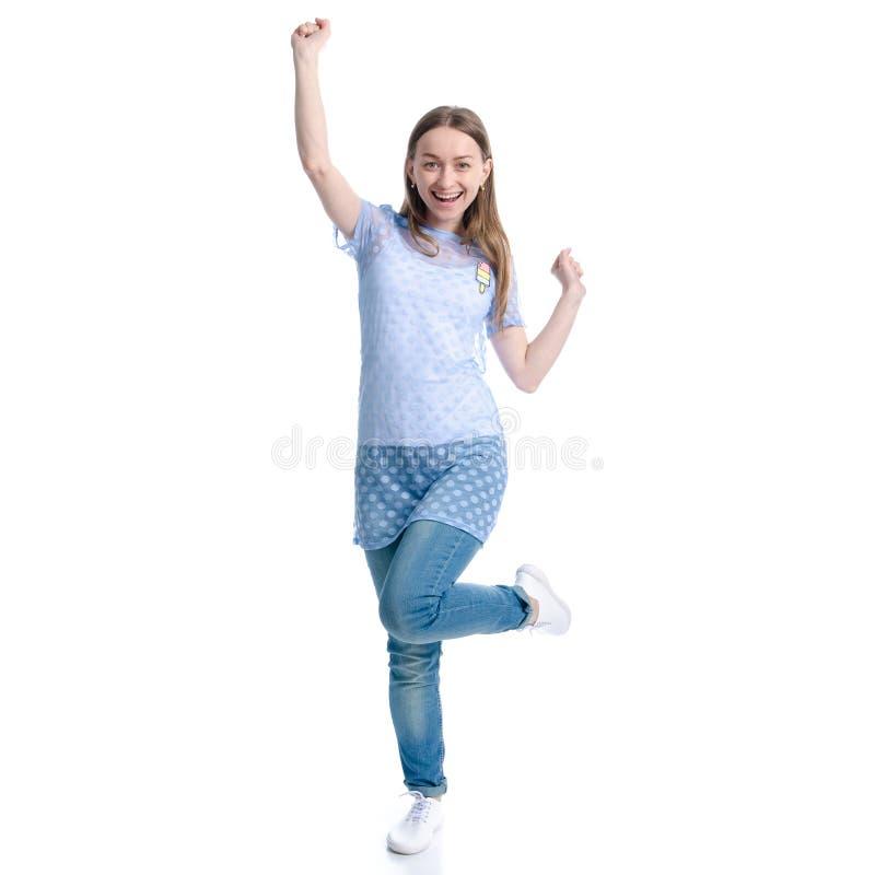 Mulher na calças de ganga que está as mãos acima da felicidade de dança imagem de stock royalty free