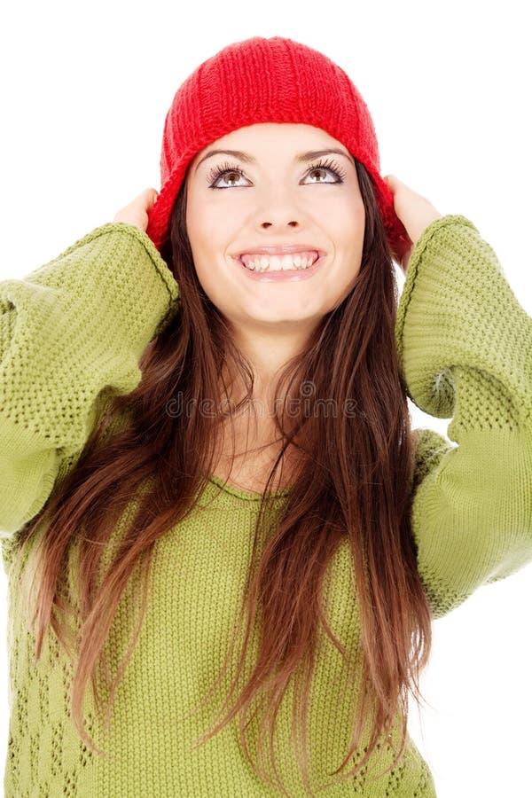 Mulher na camisola e no tampão de lãs imagem de stock