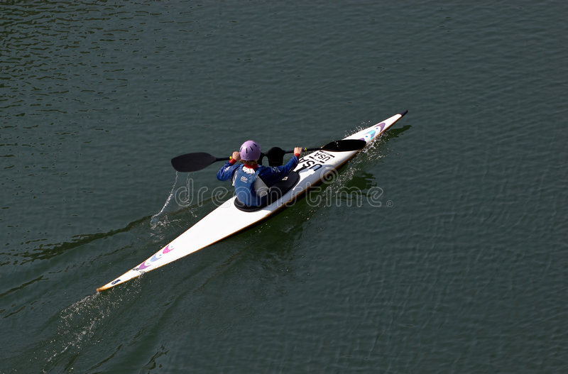Mulher na canoa fotografia de stock royalty free