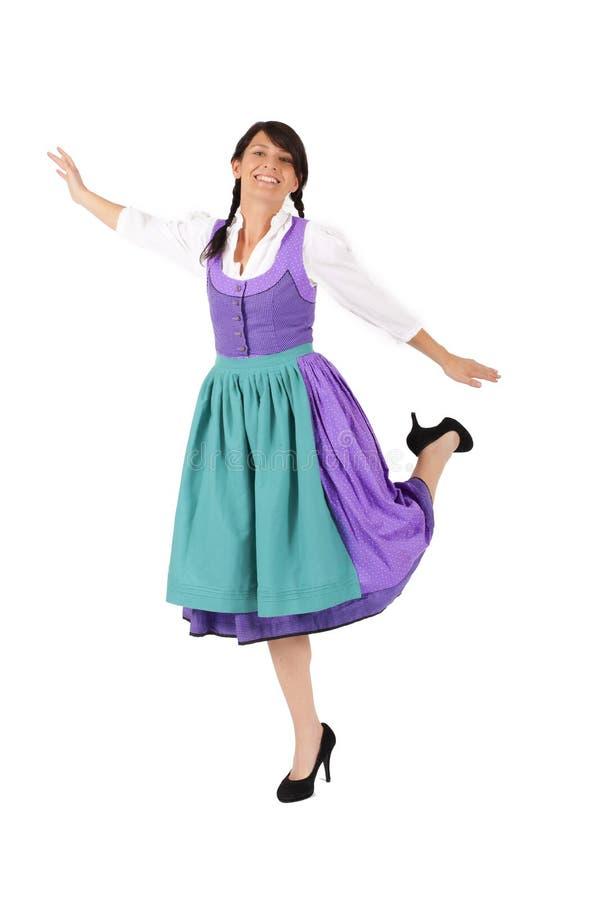 Mulher na dança do Dirndl foto de stock royalty free