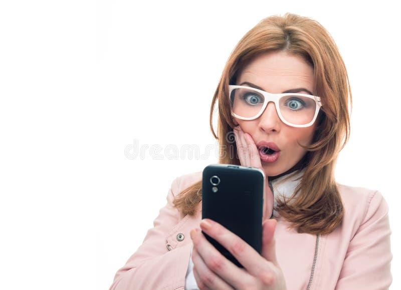 Mulher na moda no telefone fotografia de stock