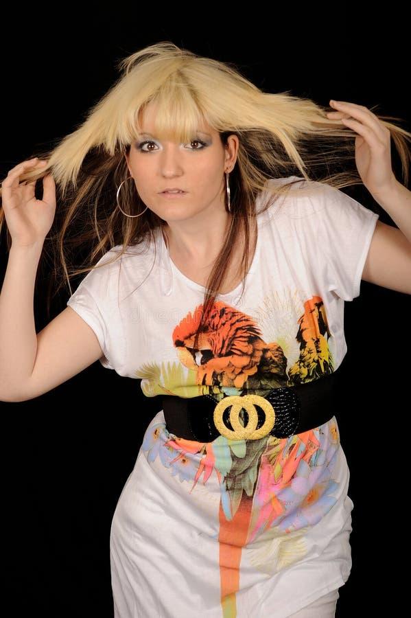 Mulher na moda que joga com cabelo imagem de stock royalty free