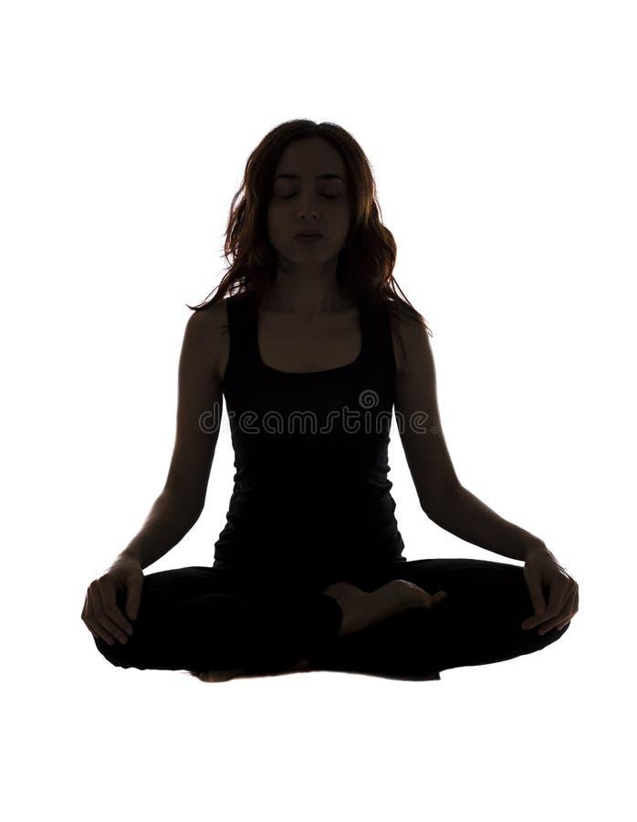 Mulher na posição assentada durante a ioga fotografia de stock royalty free