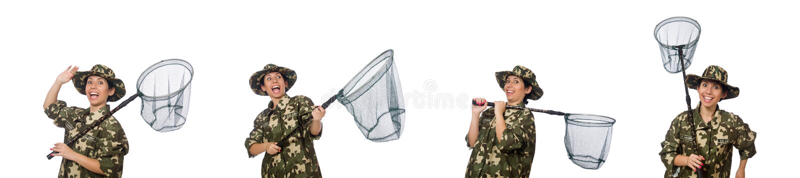 A mulher na roupa militar com rede de travamento imagens de stock
