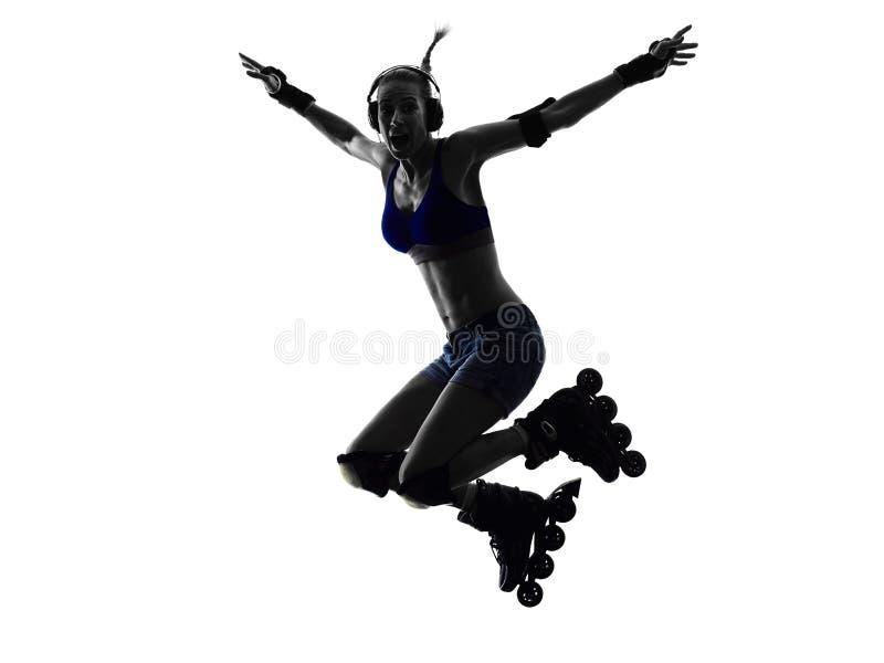 Mulher na silhueta dos patins de rolo foto de stock