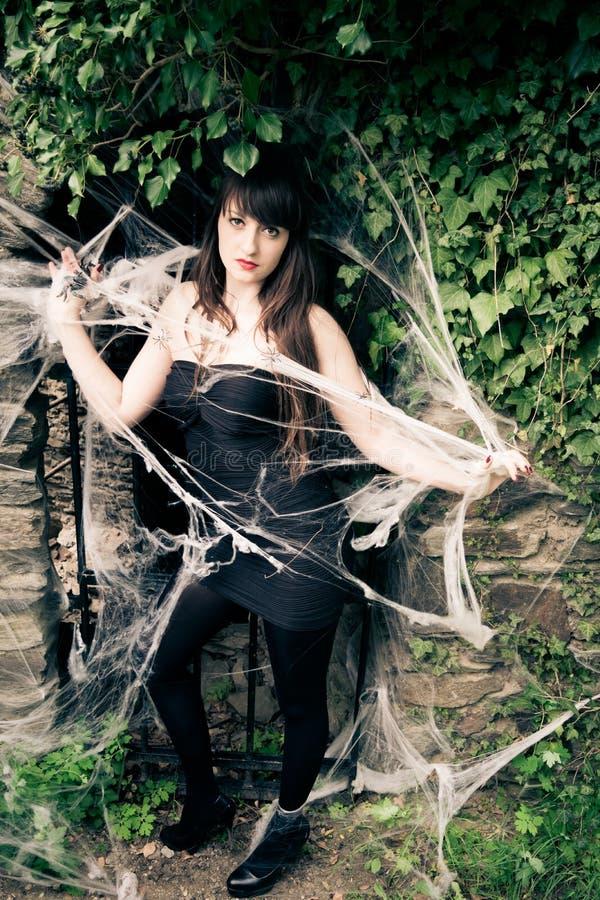 Mulher na teia de aranha fotografia de stock royalty free