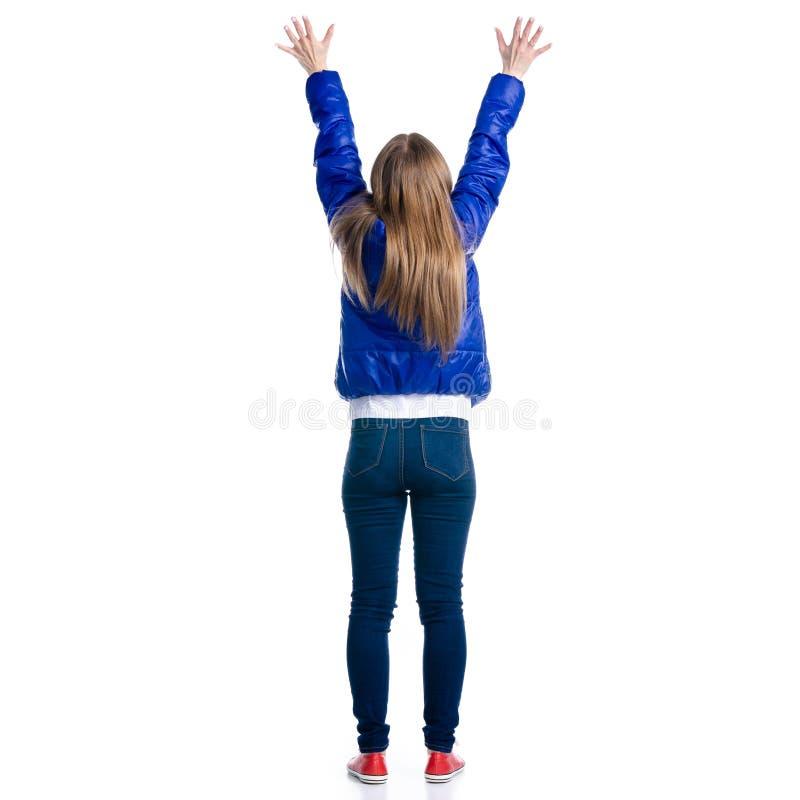Mulher nas calças de brim e nas mãos do revestimento acima foto de stock royalty free
