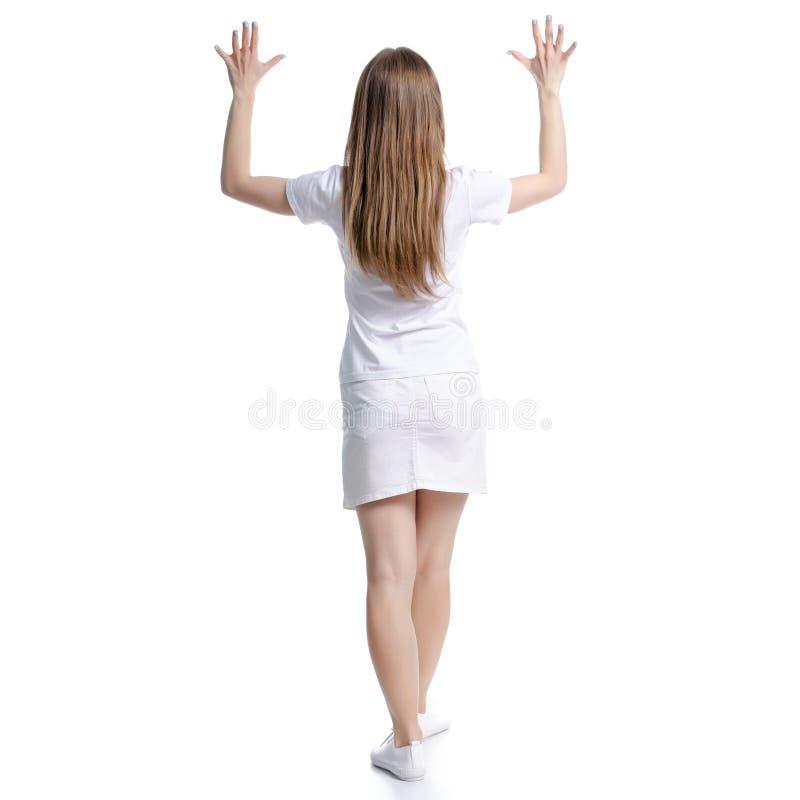 Mulher nas m?os estando brancas do t-shirt e da saia acima imagem de stock royalty free
