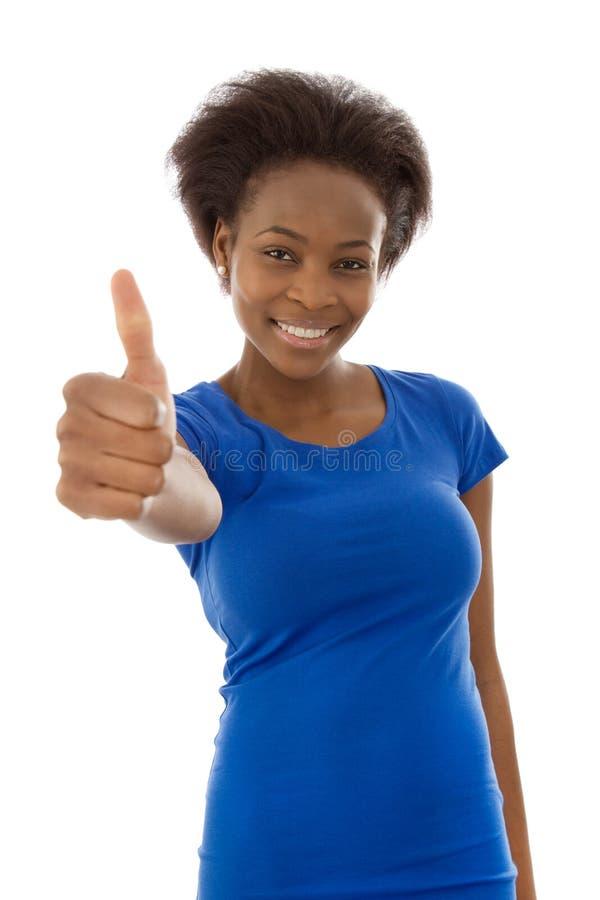 Mulher negra afro-americana isolada feliz no azul com polegares acima fotografia de stock
