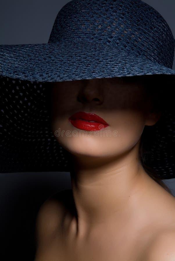 Mulher no chapéu fotografia de stock royalty free