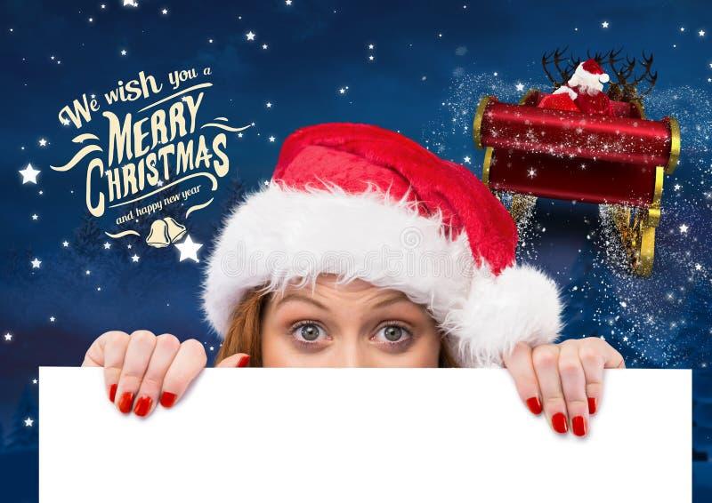 Mulher no chapéu de Santa que guarda o cartaz 3D fotografia de stock