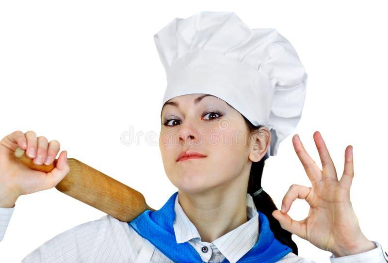 Mulher no chapéu do cozinheiro chefe imagens de stock