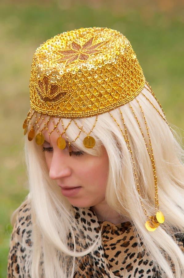 Mulher no chapéu oriental fotos de stock