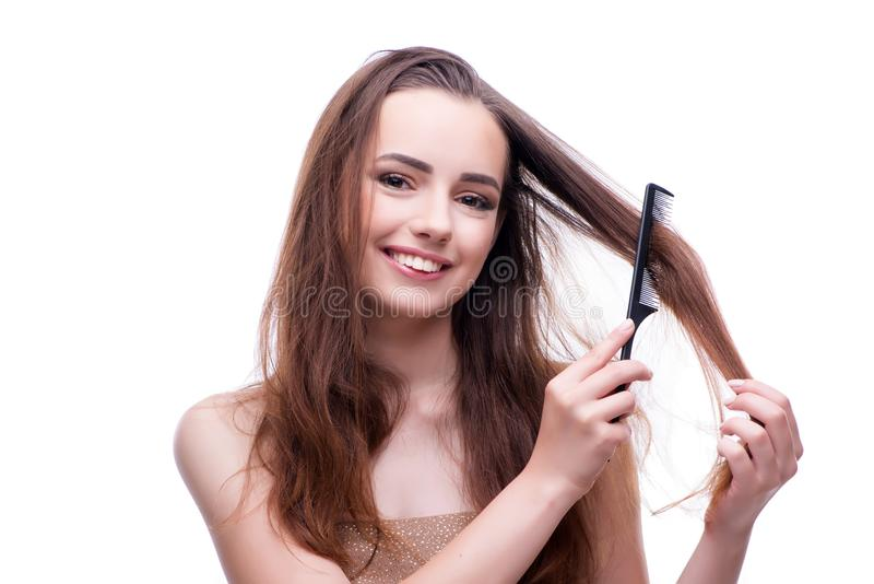 A mulher no conceito da beleza que penteia o cabelo fotos de stock royalty free