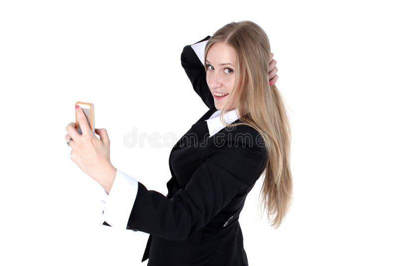 A mulher no equipamento do negócio toma um autorretrato foto de stock royalty free