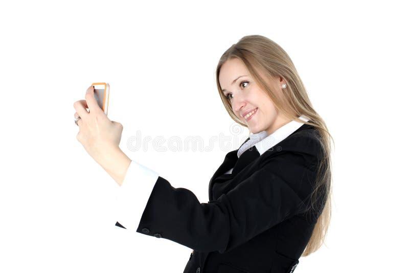 A mulher no equipamento do negócio toma um autorretrato fotos de stock