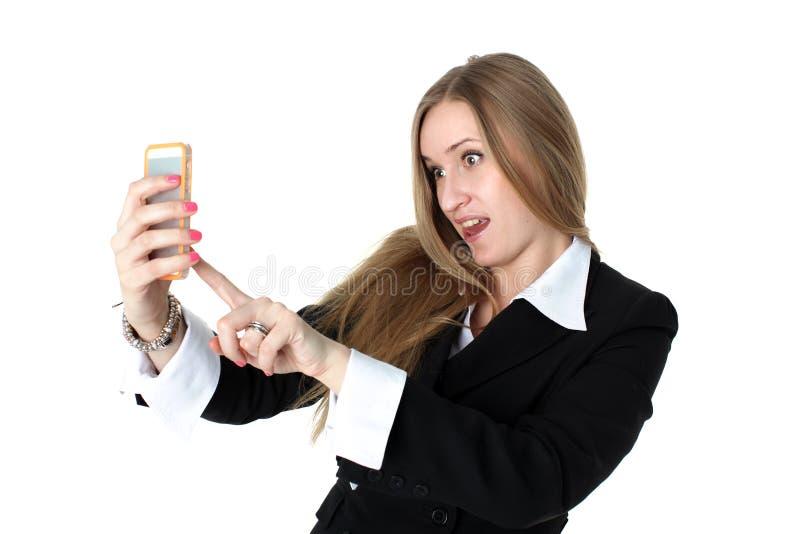 A mulher no equipamento do negócio toma um autorretrato engraçado foto de stock