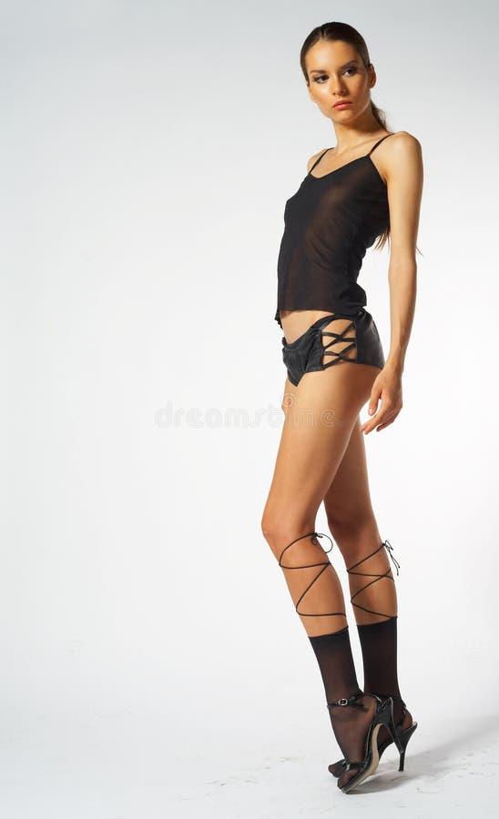 Mulher no equipamento skimpy imagem de stock
