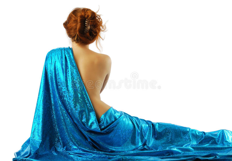 Mulher no pano azul, vista traseira. fotos de stock