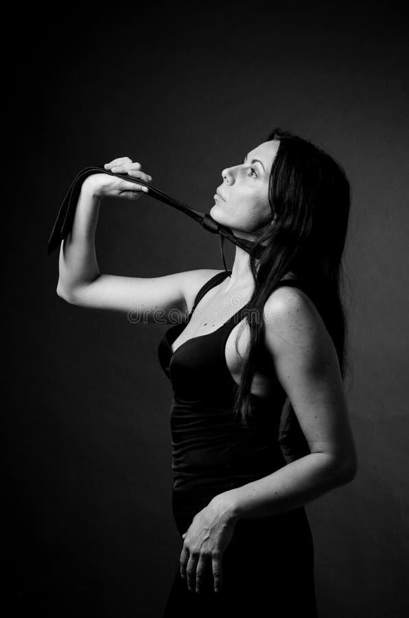 Mulher no preto fotografia de stock
