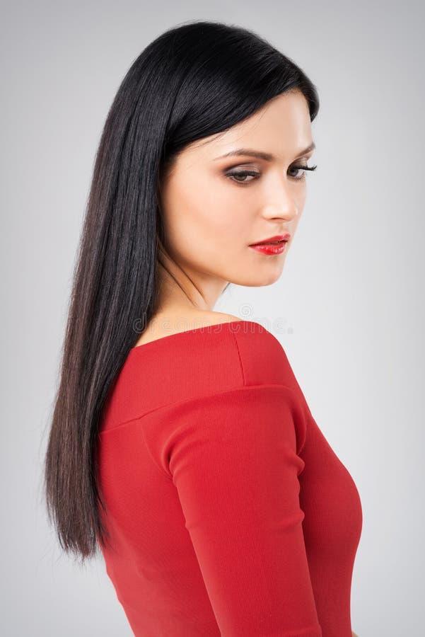 Mulher no retrato lateral vermelho imagens de stock