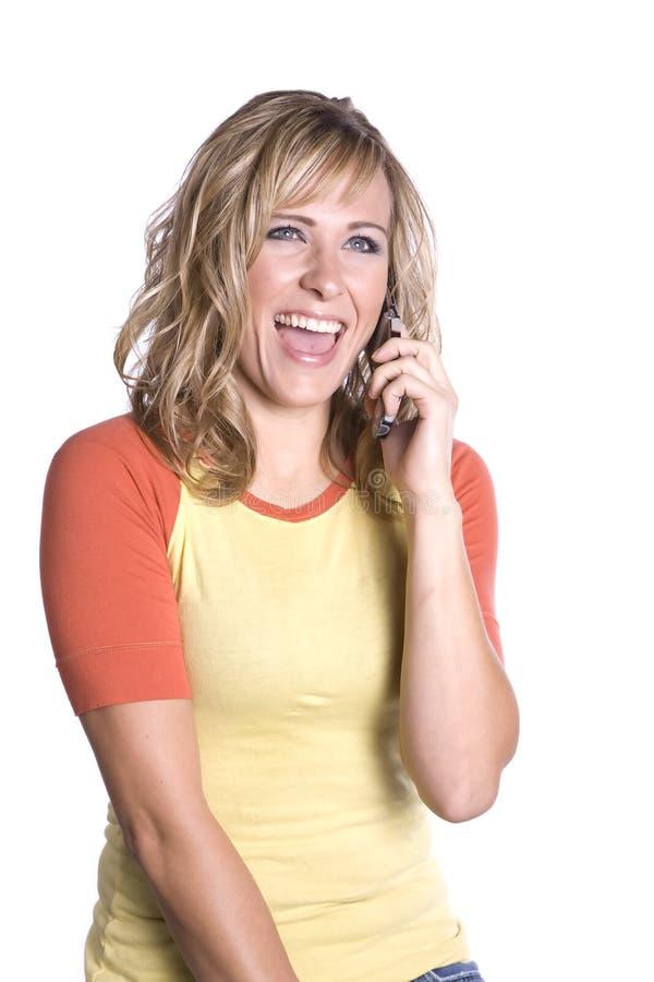 Mulher no riso do telefone imagem de stock