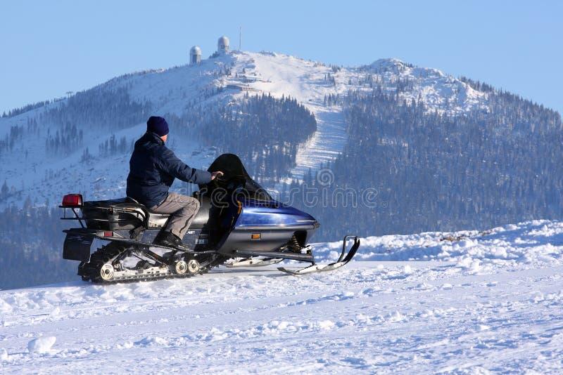 Mulher no snowmobile imagens de stock royalty free