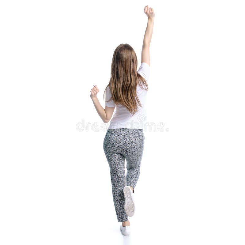 Mulher no t-shirt branco e nas mãos de dança da felicidade das calças acima fotografia de stock