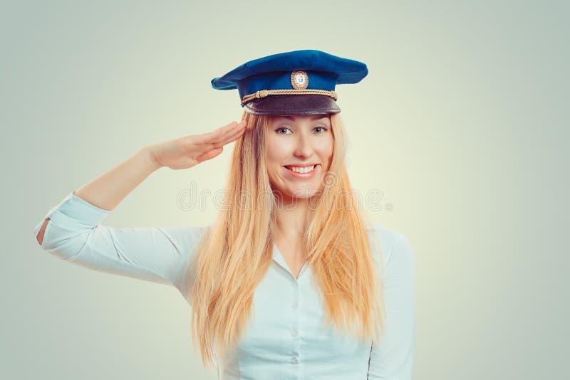 Mulher no tampão de serviço azul fotografia de stock royalty free
