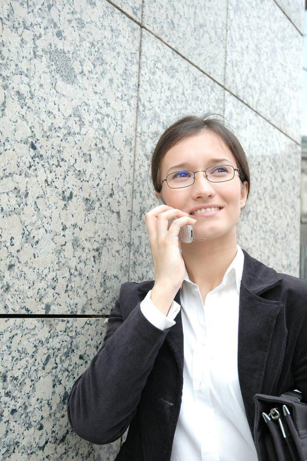 Mulher no telefone fotografia de stock
