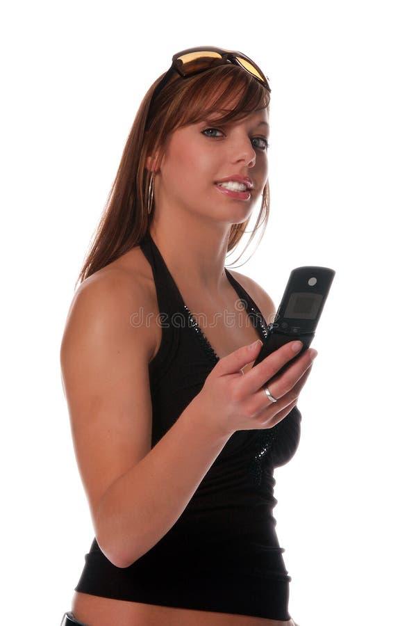 Mulher no telefone de pilha 3 fotos de stock