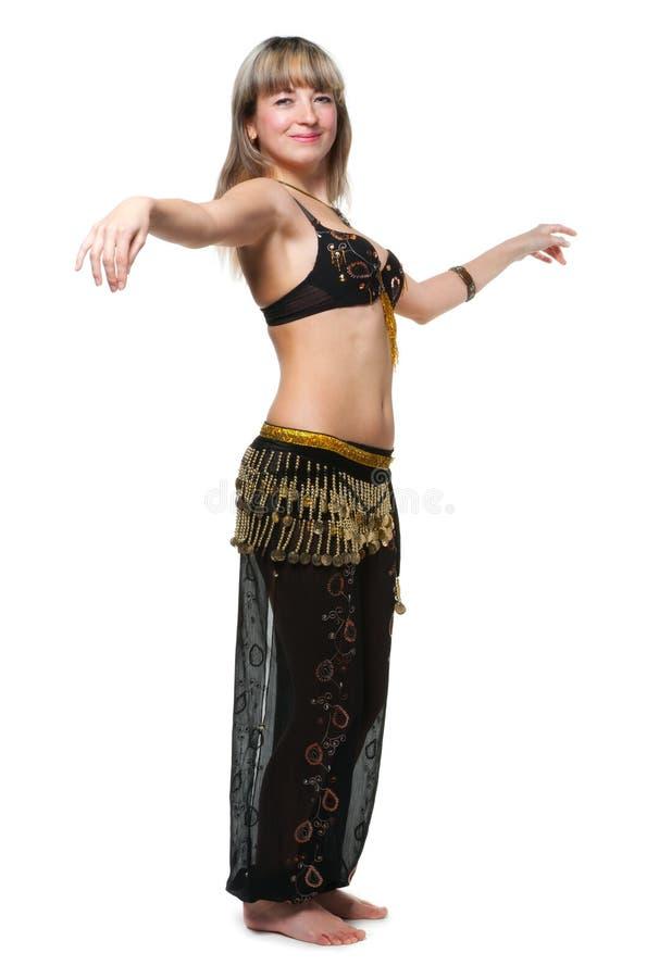 A mulher no terno de dança do leste imagem de stock