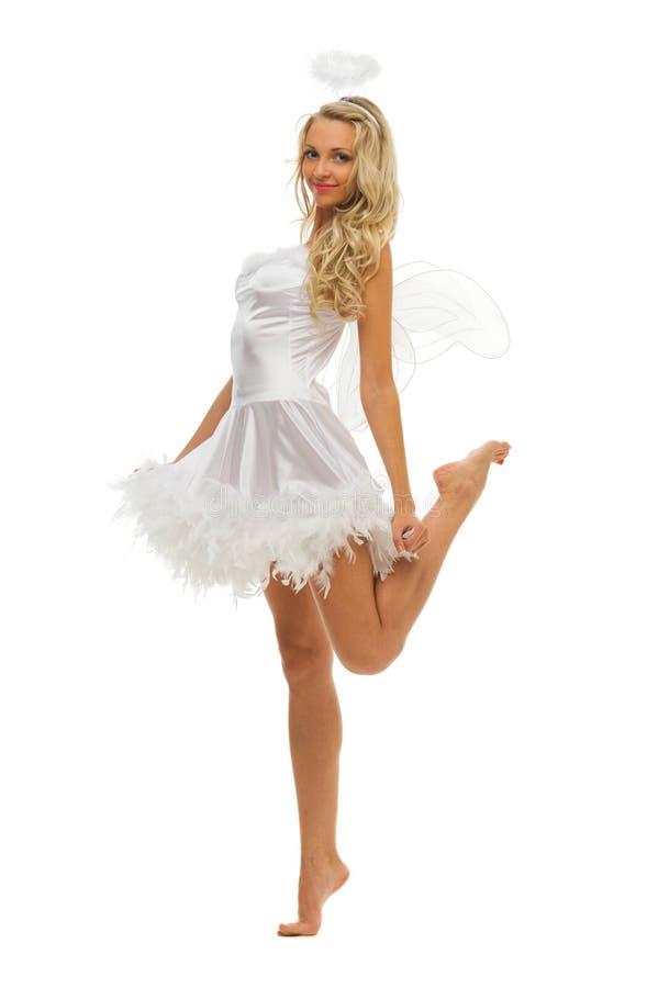 Mulher no traje do carnaval. Forma do anjo foto de stock