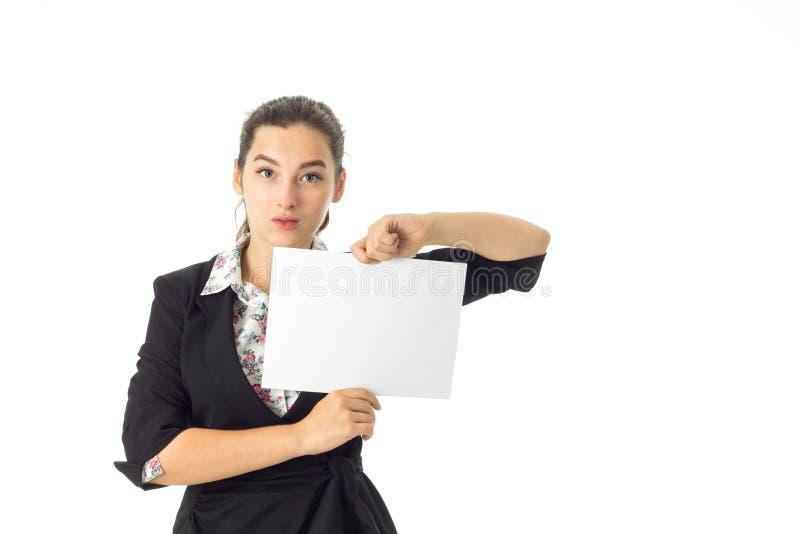 Mulher no uniforme com cartaz branco nas mãos foto de stock