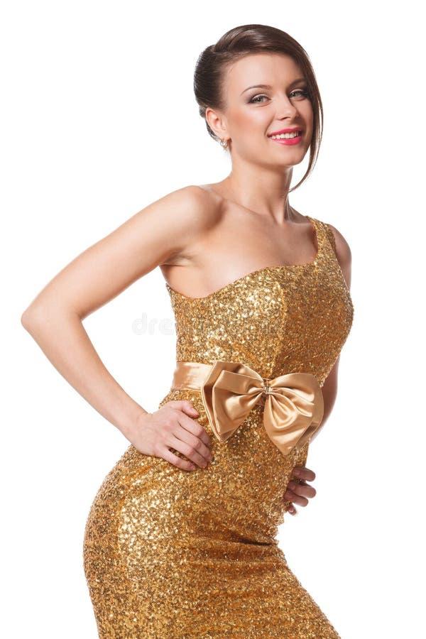 Mulher no vestido dourado imagens de stock