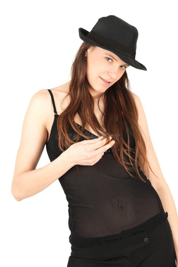Mulher no vestido e no chapéu pretos imagens de stock
