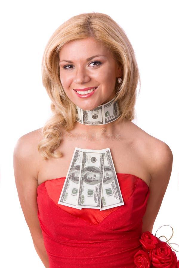 Mulher no vestido vermelho com dólares. imagem de stock royalty free