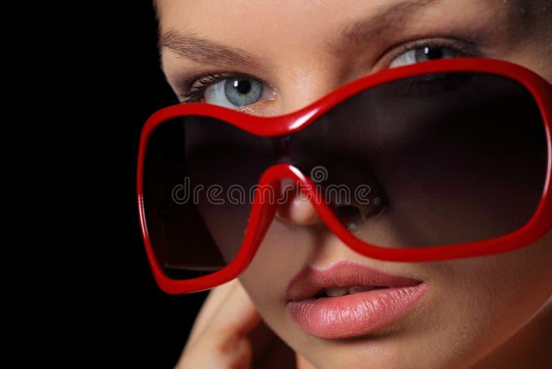 Mulher nos óculos de sol foto de stock