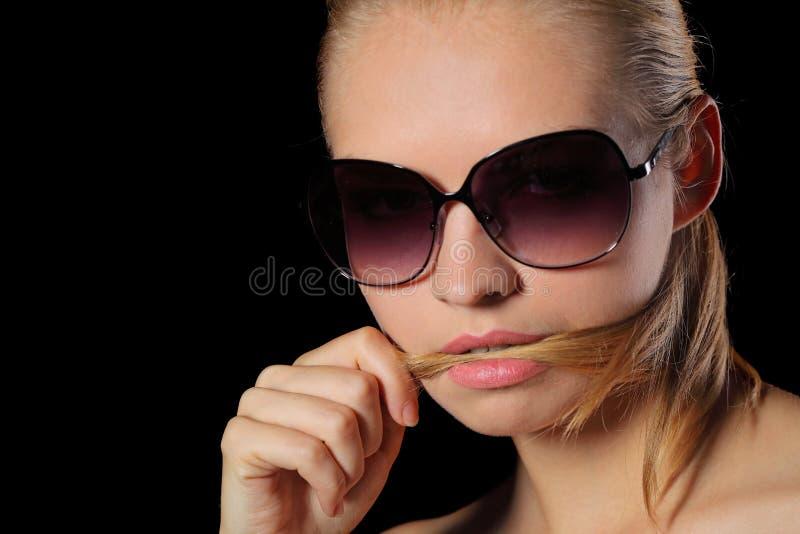 Mulher nos óculos de sol fotos de stock
